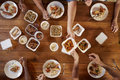 Friends at a table sharing Chinese take-away, overhead view Royalty Free Stock Photo