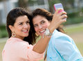 Friends taking a self portrait with mobile phone Stock Photos