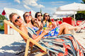 Friends tanning in beach bar four women lying on lounger the sun Royalty Free Stock Images