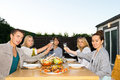Friends toasting drinks at table during outdoor party portrait of young Royalty Free Stock Photography