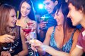 Friends toasting portrait of joyful at birthday party with focus on two laughing girls Stock Photo