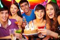 Friends toasting portrait of joyful and looking at camera at birthday party Stock Photos