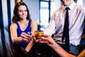 Friends toasting with shots in a bar Stock Image