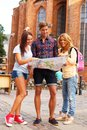 Friends tourists three tourist with map outdoors Stock Photos