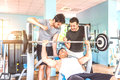Friends training in a gym Royalty Free Stock Photo
