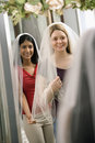 Friends trying on veils. Royalty Free Stock Image