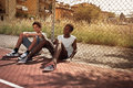Friends two young african boy resting outdoors Stock Image