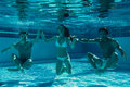 Friends under water in swimming pool