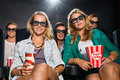 Friends watching d movie in theater portrait of happy young with popcorn and soda Royalty Free Stock Images