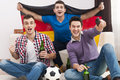 Friends watching football game excitement men cheering match Stock Photography
