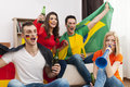 Friends watching football game multi ethnic group of people cheering match Royalty Free Stock Images