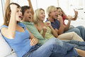 Friends Watching A Game On Television Stock Image