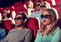 Friends watching horror movie in 3d theater Royalty Free Stock Photo
