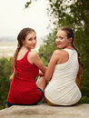 Friendship, happiness and people concept - two smiling girls out Royalty Free Stock Photo