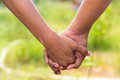 Friendship and holding hands on nature Royalty Free Stock Photos