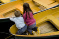 Friendship. kids playing in boat Royalty Free Stock Photo