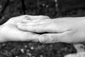 Friendship old and young female hands as the sign of Royalty Free Stock Image