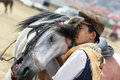 Friendship between rider and horse young hug his s neck after wining traditional turkish breeding horses Stock Photos