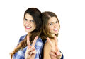 Friendship two happy female friends showing victory sign with hands Royalty Free Stock Photography