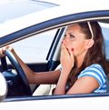 Fright face of woman in the car. Royalty Free Stock Photo