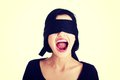Frighten young blindfold woman screaming portrait of a beautiful Stock Images