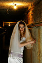 Frightened bride in dungeon Stock Image
