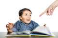 Frightened little boy looks at a finger that points to homework pointing the school book looking Stock Image