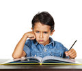 Frightened little boy looks at a finger that points to homework pointing the school book looking Royalty Free Stock Photography