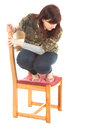 Frightened overweight woman on the chair Royalty Free Stock Photo