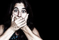 Frightened woman covering her mouth Royalty Free Stock Images