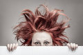 Frightened woman with messy hair Royalty Free Stock Photo