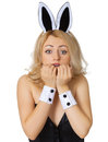 Frightened young girl in rabbit costume on white Stock Photos