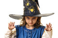 Frightening halloween little girl at with magician hat mysterious and evil look hands like claws isolated on white background Royalty Free Stock Image