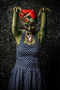 Frightening pin up zombie girl over dark background body painting project halloween make horror Stock Images