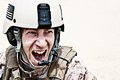 Frightening scary face of us marine in the marpat uniform showing teeth Royalty Free Stock Photo