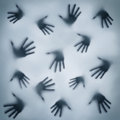 A frightening silhouette of many different hands Royalty Free Stock Photography