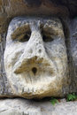 Frightening stone head rock sculpture in the forest from by sculptor vaclav levy Stock Photo