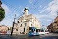 stock image of  Frilly advertising tram rides in front of the church of old city
