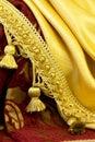Fringe on the background of fabrics golden curtain Royalty Free Stock Images