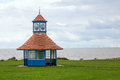 Frinton clock tower shelter the located on the greensward at on sea with the gunfleet sands offshore wind farm in the background Stock Photos
