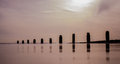Frinton sea front beach partition and reflections in the Royalty Free Stock Photo