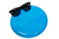 Frisbee and sunglasses with lots of copy space on white background Royalty Free Stock Photography
