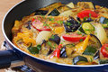 Frittata roast mediterranean vegetables aubergine courgette capsicum onion tomato frying pan Stock Images