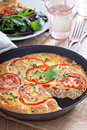 Frittata with vegetables and ham tomatoes red peppers mustard Stock Images