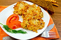 Fritters of minced chicken on a white plate with tomato and dill knife fork napkin orange rye bread on a wooden board Stock Images
