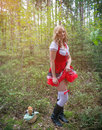 Frivolous little red riding hood a young woman showing a in the forest Royalty Free Stock Photos