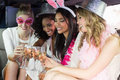 Frivolous women drinking champagne in a limousine on night out Royalty Free Stock Photography