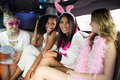 Frivolous women in a limousine on night out Stock Photos