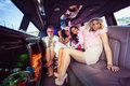 Frivolous women in a limousine on night out Stock Images