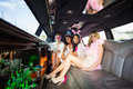 Frivolous women in a limousine on night out Royalty Free Stock Photos